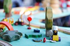 儿童的在轨道的玩具火车 免版税库存照片