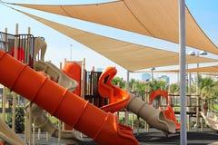 儿童的游乐场和遮篷 免版税库存图片