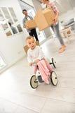 儿童的自行车的女婴在家 库存图片