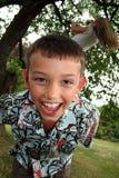 儿童笑作用 免版税库存图片