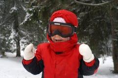 儿童笑的滑雪 免版税库存图片