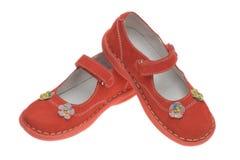 儿童红色鞋子 免版税库存照片