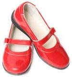 儿童红色s鞋子涂了清漆 免版税库存图片