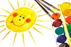 儿童绘画s微笑的星期日 库存照片