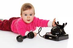 儿童老电话作用 免版税库存照片