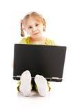 儿童膝上型计算机纵向 免版税库存图片