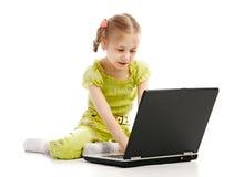 儿童膝上型计算机纵向 图库摄影