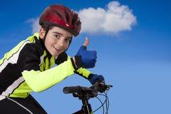 儿童自行车运动服 免版税图库摄影
