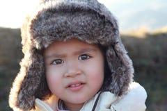儿童裘皮帽纵向 免版税库存照片