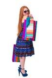 儿童购物。 愉快的方式有购物的一点红头发人女孩 免版税图库摄影