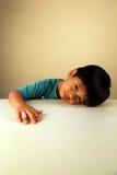 儿童逗人喜爱查找哀伤 图库摄影