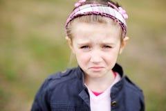 儿童逗人喜爱的表面女孩做生气要哭 免版税库存图片