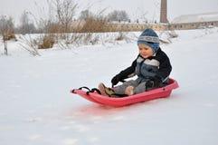 儿童雪撬 图库摄影