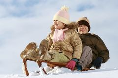 儿童雪撬 库存图片