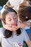 儿童面孔绘画的车间 图库摄影