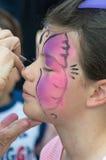 儿童面孔绘画 免版税库存图片