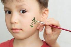 儿童面孔绘画 图库摄影