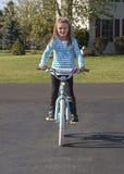儿童骑马自行车 免版税库存照片