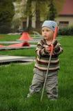 儿童高尔夫球运动员画象 免版税图库摄影