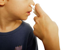 儿童鼻孔喷射 免版税图库摄影