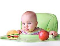 儿童` s健康营养概念 吃食物的婴孩 查出 免版税库存照片