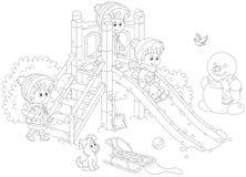 儿童` s幻灯片在公园 免版税库存照片