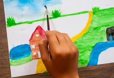 儿童` s手画与水彩的一张图片 库存图片