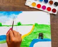 儿童` s手画与水彩的一张图片 免版税库存照片