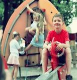 儿童` s操场的快乐的男孩 图库摄影