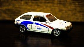 儿童` s玩具`汽车` 白色斜背式的汽车 免版税库存照片