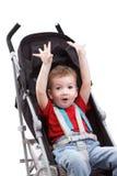 婴儿车的,在白色隔绝的手逗人喜爱的孩子 图库摄影