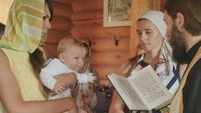 婴儿洗礼仪式在教会里 影视素材