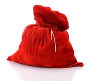 充分圣诞老人红色袋子,在空白背景 库存图片