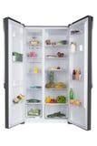 充分打开冰箱新鲜的水果和蔬菜 免版税库存照片
