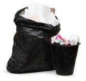 充分的废字纸篓和塑料袋 免版税库存图片