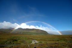 充分的彩虹在冰岛 免版税库存照片