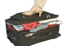 充分的手提箱 库存图片