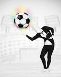 充分的身体衣服holdig足球的人 免版税库存图片