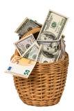 充分篮子在白色背景隔绝的金钱 免版税库存图片