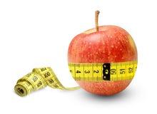 充分苹果力量和卫生措施它的腰部并且相当是结果 适当的营养的标志 免版税图库摄影