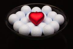 充分黑陶瓷碗高尔夫球 免版税库存照片