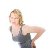 充满背部疼痛的少妇 免版税图库摄影
