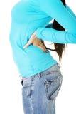 充满背部疼痛的青少年的学员妇女 免版税库存照片