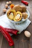 充满蛋惊奇的小圆面包 免版税库存图片