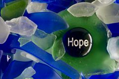 充满书面的希望的玻璃石头打印了对此 库存照片