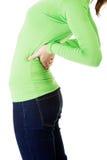充满背部疼痛的青少年的学生妇女 免版税库存图片