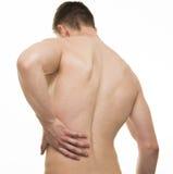 充满背部疼痛的年轻人-在白色隔绝的演播室射击 库存照片