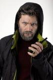 先生 送冰人侵略,他谈话在携带无线电话 库存图片