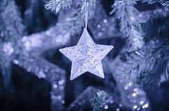 光亮的圣诞节星装饰-抽象颜色 图库摄影