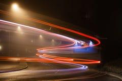 一辆通过的公共汽车的图片乘与长的曝光 免版税库存照片